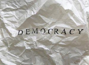 Crumpled paper with the word democracy