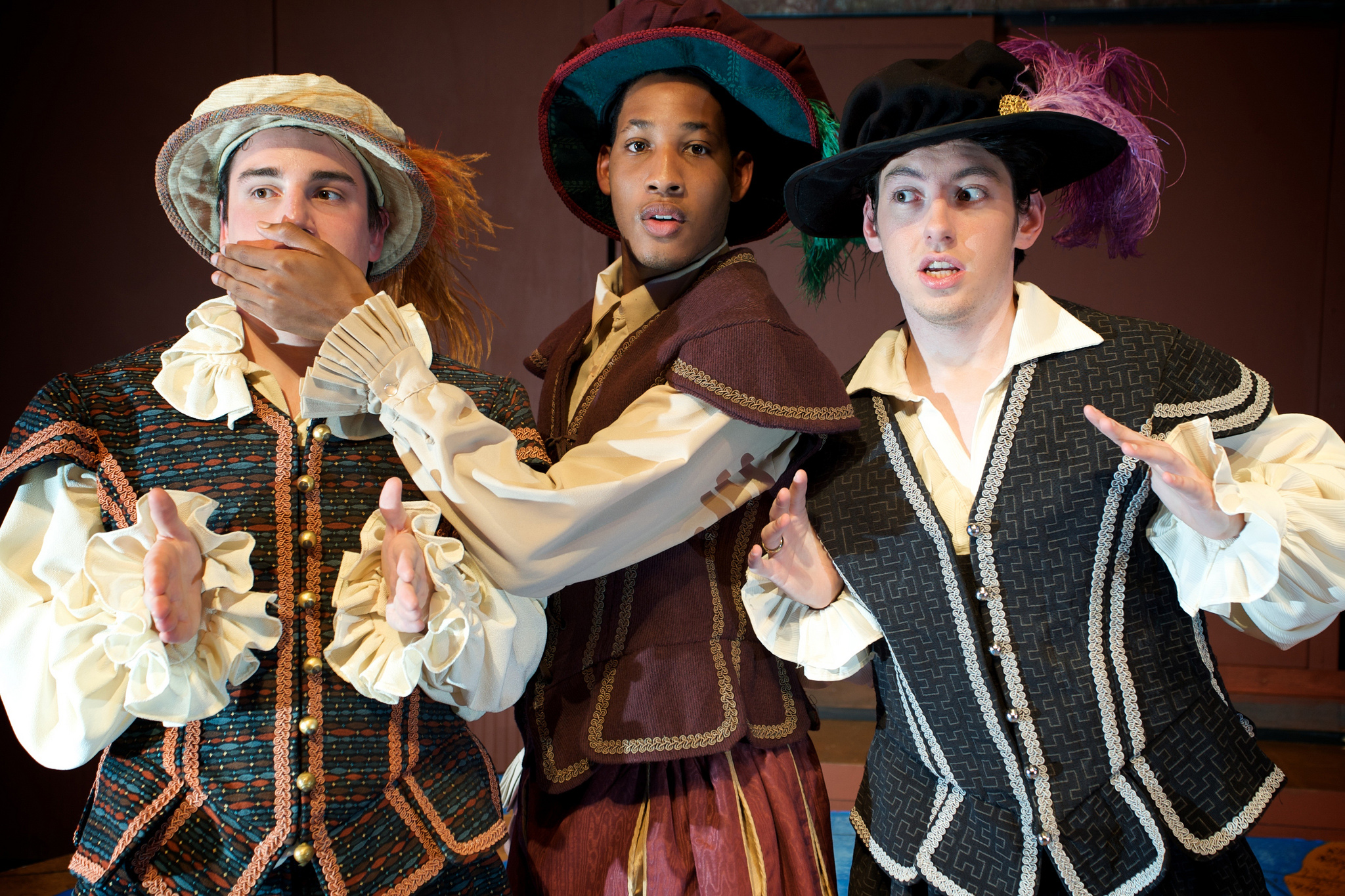 3 male actors performing in a show called rhymes with venus